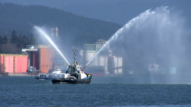 Tug Boat Spraying Water Backwards In The Harbor (HD 1080p30) video