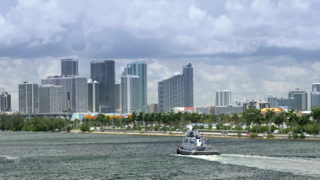 Tug Boat Travels Past Miami Skyline video
