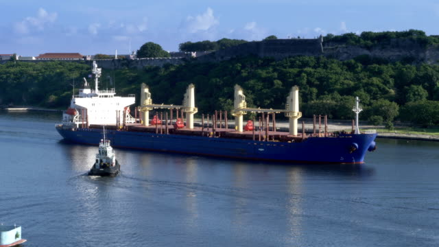 Tug Boats Guide Freighter Ship into Havana Port in Cuba video
