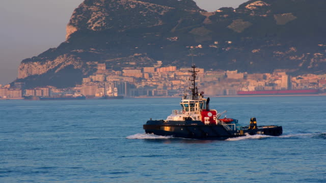 tug underway in harbor area in mediterranean - rimorchiatore video stock e b–roll