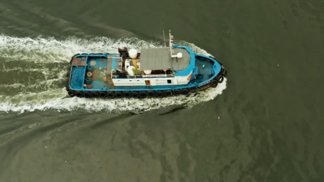 Tugboat on the river Tugboat on the river surface, aerial view. Manila, Philippines towing stock videos & royalty-free footage