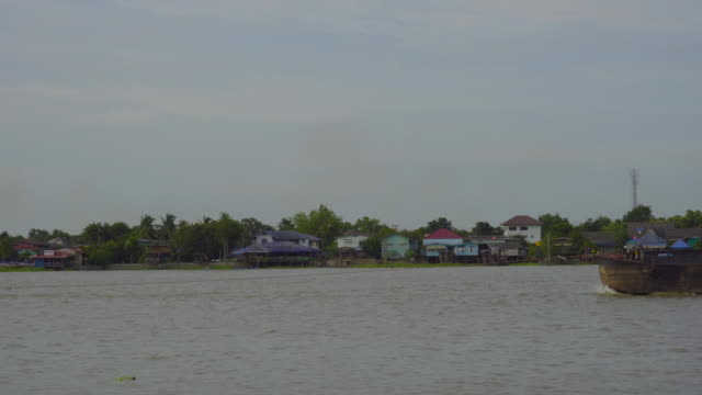 Tugboats is sailing in the Chao Phraya River, Thailand.