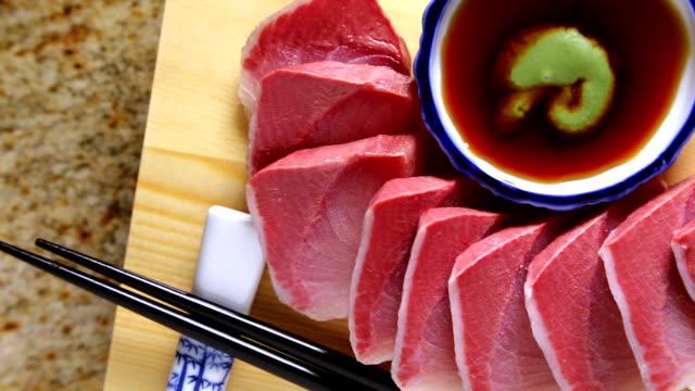 Tuna Sashimi Dolly Shot of Fresh Tuna,Yellow Fin Tuna, Sashimi on Table. sashimi stock videos & royalty-free footage