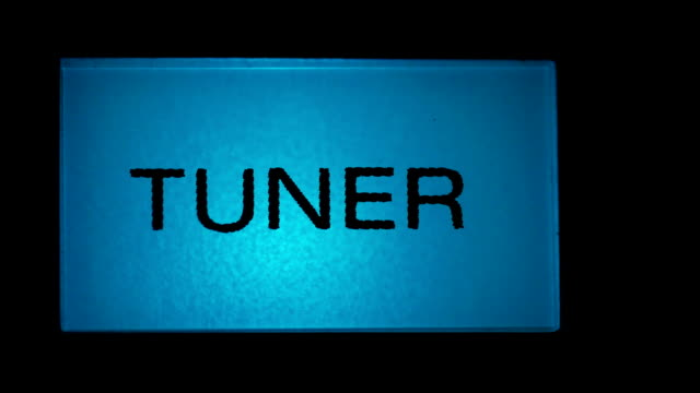 Tuner button blue color on black background of radio receiver video