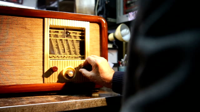 tuning a vintage radio - radio video stock e b–roll