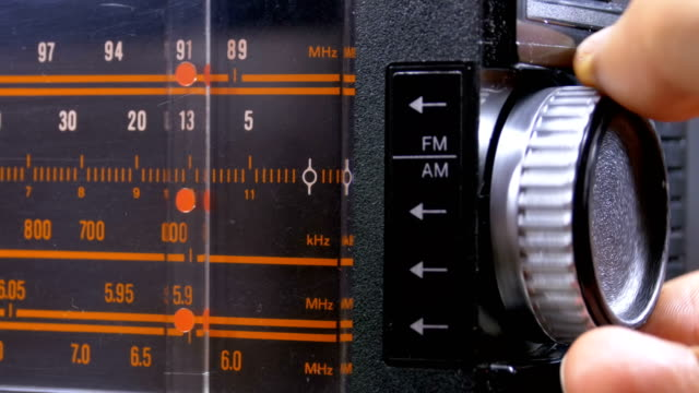 tuning analog radio dial frequency on scale of the vintage receiver - radio video stock e b–roll