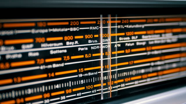 tuning analog scale of the retro radio with the names of cities, radio stations and frequency - analogico video stock e b–roll