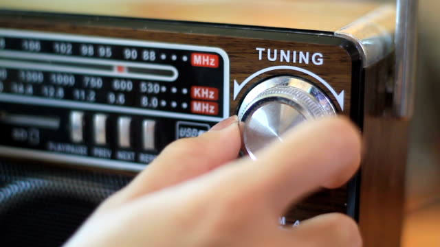 tuning fm radio stations on receiver dial - radio video stock e b–roll
