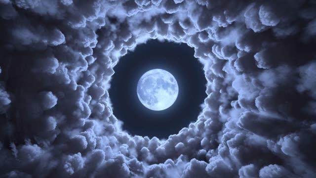 tunnel tra le nuvole e la luna - onirico video stock e b–roll