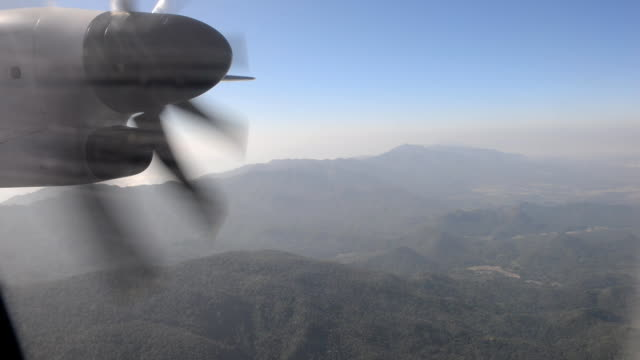 Turboprop airplane flying over mountain video