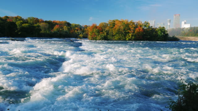 Turbulent Niagara River before the waterfall. On a clear autumn day video