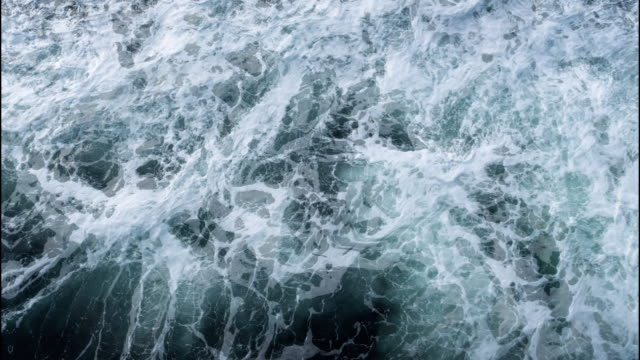 Turbulent Water in Motion Cinemagraph Turbulent water with foam in motion. Cinemagraph. High angle view. scandinavia stock videos & royalty-free footage