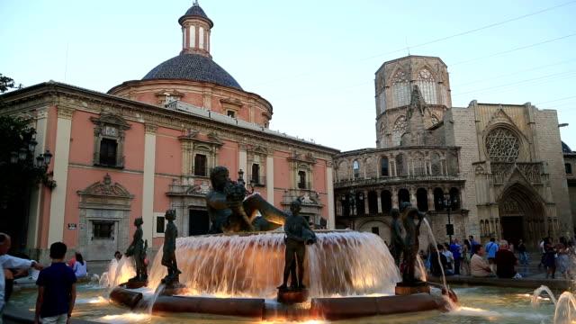 turia fountain in the plaza de la virgen - gothic fashion stock videos and b-roll footage