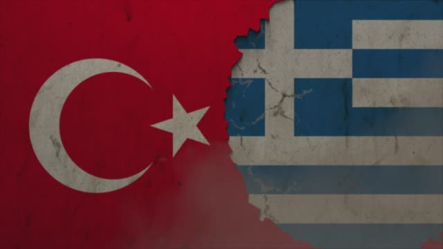 Turkey and Greece flags on the stone wall stock video