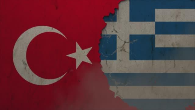 türkei und griechenland flaggen auf der steinmauer stock video - griechenland stock-videos und b-roll-filmmaterial