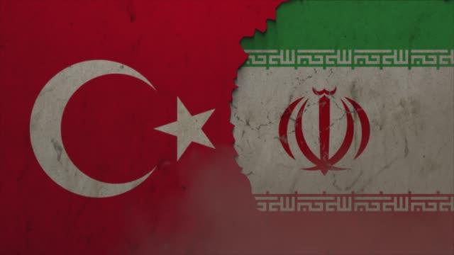 türkei und iran flaggen auf der steinmauer stock video - ankara türkei stock-videos und b-roll-filmmaterial