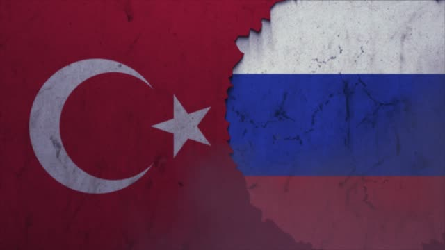Turkey and Russia flags on the stone wall stock video