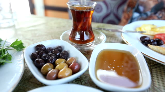 Turkish breakfast Oriental Turkish breakfast with tea honey olive herbs scrambled eggs cheese turkish culture stock videos & royalty-free footage