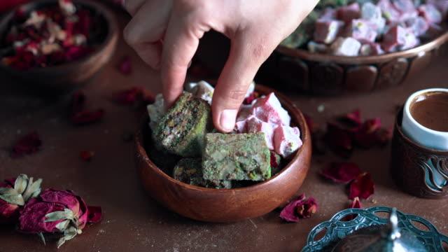 turkish coffee and turkish delight lokum - taking turkish delight from bowl - cultura turca video stock e b–roll