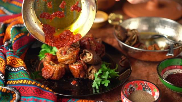 Turkish Dishes: Stuffed Dried Eggplant and Pepper Turkish traditional Gaziantep food.// Gaziantep usulü Kuru patlican ve biber dolmasi. mardin stock videos & royalty-free footage