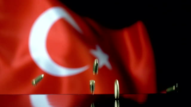 turkish flag behind bullets falling in slow motion - cultura turca video stock e b–roll