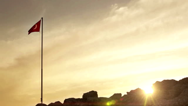 Turkish flag flutters in the wind at sunset video