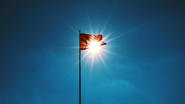 turkish flag waving at blue sky. turkey country flag flowing in the wind at blue sky. - полумесяц форма предмета стоковые видео и кадры b-roll