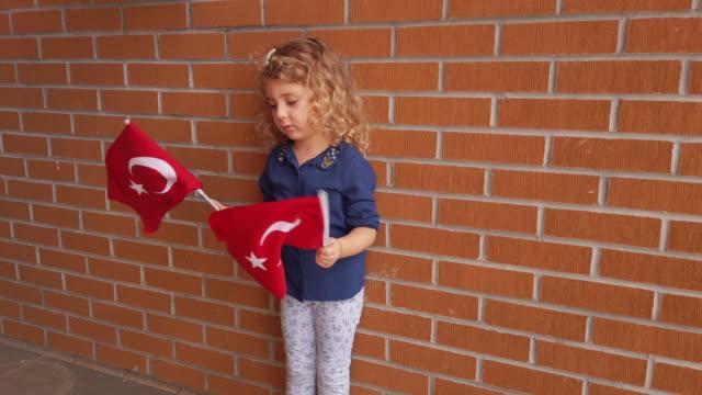 turkish girl waving flag - cultura turca video stock e b–roll