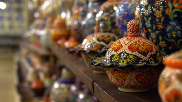 Turkish pottery close up Turkish pottery painting, Turkish painting pottery in market, Turkish painting on a gas lamp, Turkish painted ceramics, Souvenir homemade wares for tourists in Avanos painting art product stock videos & royalty-free footage