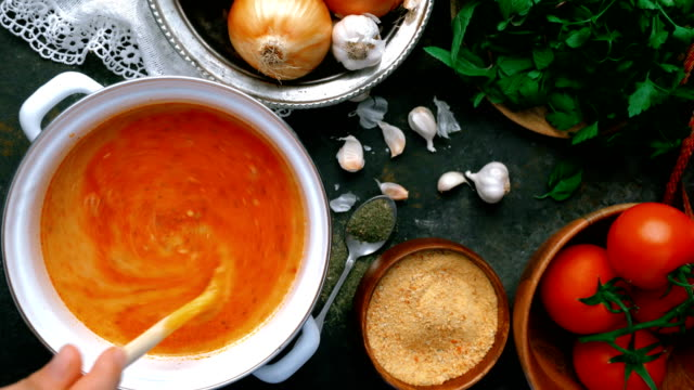 Turkish Tarhana Soup - Mixing with Wooden Spoon Making of Turkish traditional tarhana soup. Tomato paste, onion, garlic, parsley, salt, black pepper, olive oil, red pepper powder. Overhead shot. spice stock videos & royalty-free footage