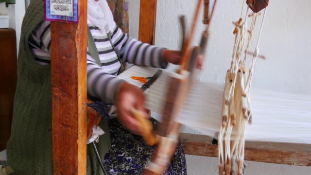 Turkish woman weaving loom machine, Turkey video