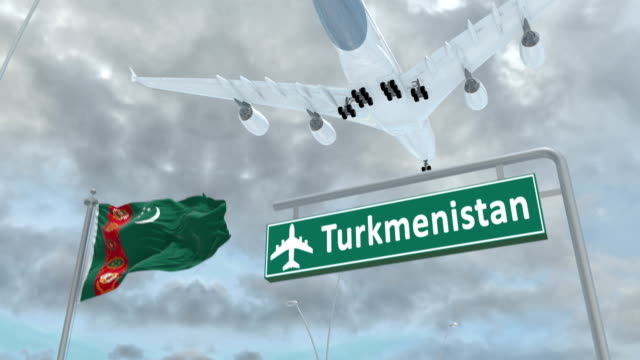 Turkmenistan, approach of the aircraft to land Turkmenistan, approach of the aircraft to land in сloudy weather, flying over the name of the country and its flag turkmenistan stock videos & royalty-free footage