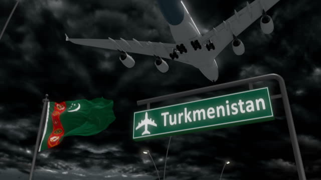 Turkmenistan, approach of the aircraft to land Turkmenistan, approach of the aircraft to land at night in cloudy weather, flying over the name of the country and its flag turkmenistan stock videos & royalty-free footage