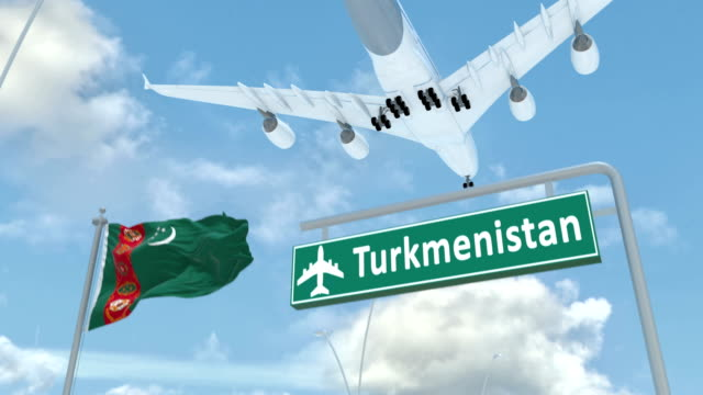 Turkmenistan, approach of the aircraft to land Turkmenistan, approach of the aircraft to land in low-cloud weather, flying over the name of the country and its flag turkmenistan stock videos & royalty-free footage