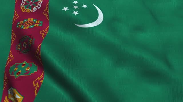 Turkmenistan flag waving in the wind. National flag of Turkmenistan Turkmenistan flag waving in the wind. National flag of Turkmenistan. 3d render. seamless loop turkmenistan stock videos & royalty-free footage