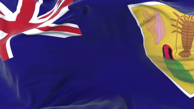 stockvideo's en b-roll-footage met turks and caicos islands vlag zwaaien op wind met blauwe hemel, lus - providenciales