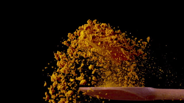 Turmeric on a Spoon in Super Slow Motion 1000 fps Turmeric on a Spoon in Super Slow Motion 1000 fps spice stock videos & royalty-free footage