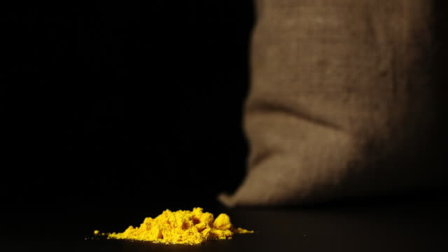 STOP-MOTION: Turmeric powder heap growing near a sac STOP-MOTION: Turmeric powder heap growing near a sac sac stock videos & royalty-free footage