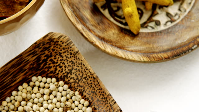 Turmeric raw seed, bay leaf and seed in bowl 4k video
