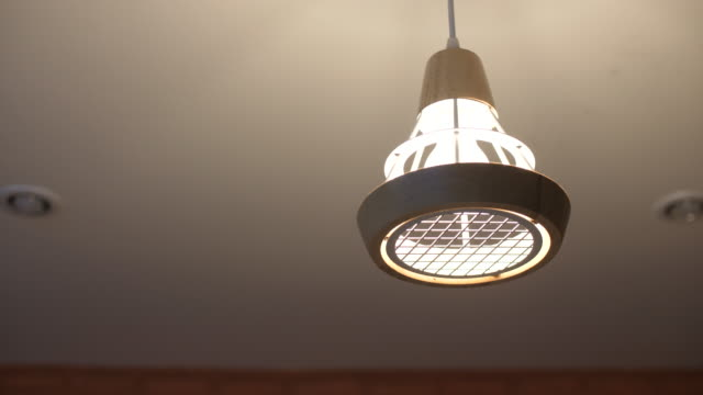 turn on light in ceiling - soffitto video stock e b–roll