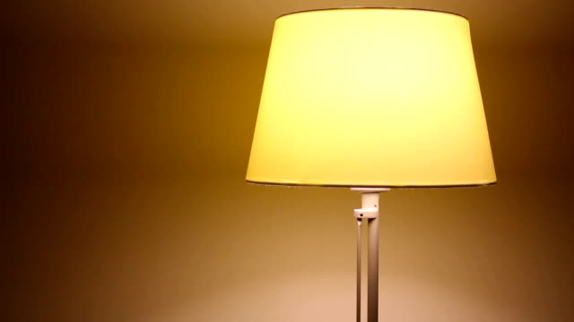 Turn On - Turn Off Table Lamp yellow small bedside lamp in the apartment start button stock videos & royalty-free footage