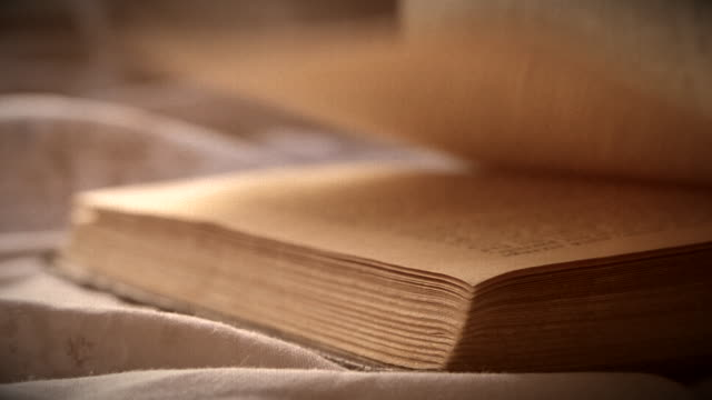 Turn over sheets an old vintage book close-up lying on a flat surface
