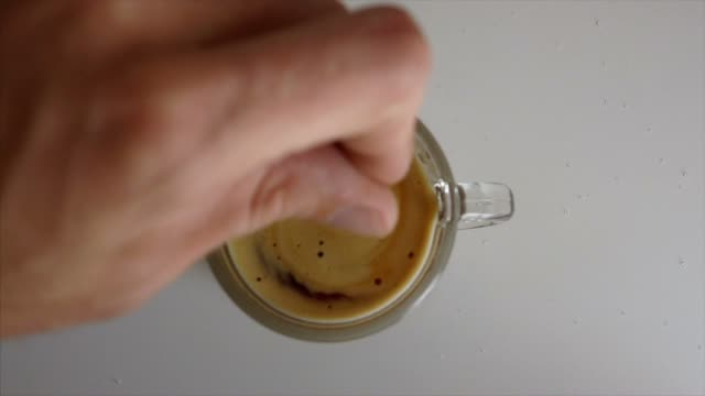 Turn the sugar into the coffee Man turning sugar into coffee spoon stock videos & royalty-free footage