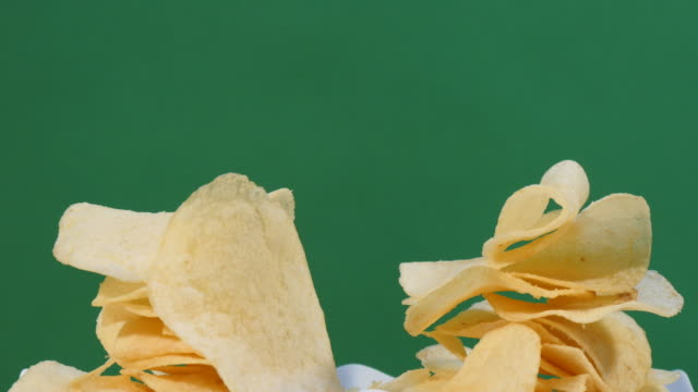 Turning a pile of potato chips Turning a pile of potato chips studio workplace stock videos & royalty-free footage