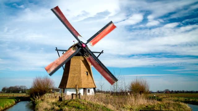 turning historic windmill in the netherlands - dutch architecture stock videos & royalty-free footage