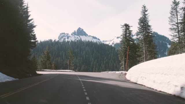 Turning Left Snowy Curved Road Unicorn Mountain Peak Tatoosh Range video