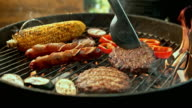 istock SLO MO LD Turning meat while grilling 606086974