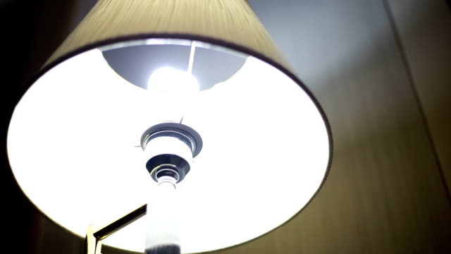 Turning on a lamp Video HD of Turning on a lamp lamp shade stock videos & royalty-free footage