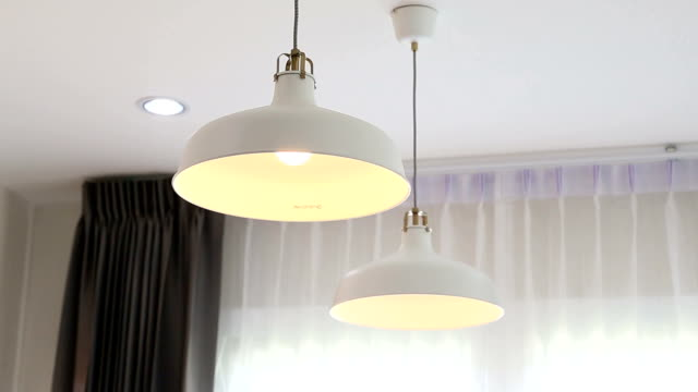 Turning on and off bulbs light. Turning on and off bulbs light indoors. electric light stock videos & royalty-free footage