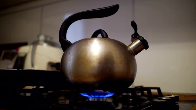 turning on and off flame under teapot. - teapot stock videos & royalty-free footage